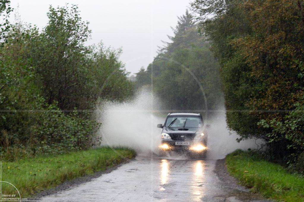 Hyundai Terracan in torrential rain | Drive-by Snapshots by Sebastian Motsch (2013)