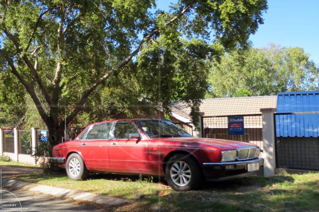 Parked under a tree in ZA Jaguar XJ   Drive-by Snapshots by Sebastian Motsch (2012)